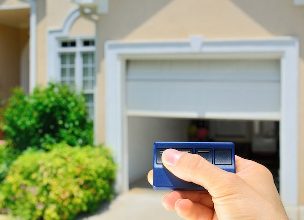 An electronic garage door opener being tested by a homeowner