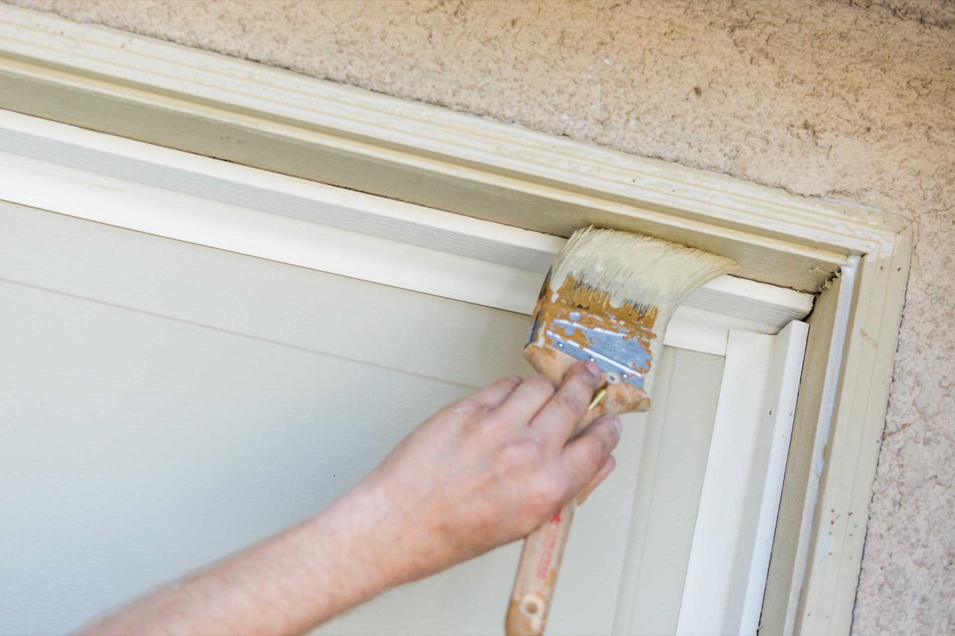 Painter painting garage door